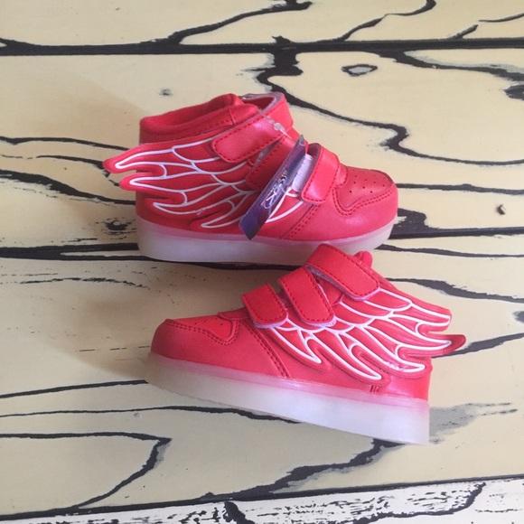 efa32aa91ebf Kids red winged led light up shoe. NWT. boutique.  M 5baf0f10aa57196315ff218c. M 5baf0e8f3e0caa36f030493f.  M 5b43c6dd3c98449e84808ea1